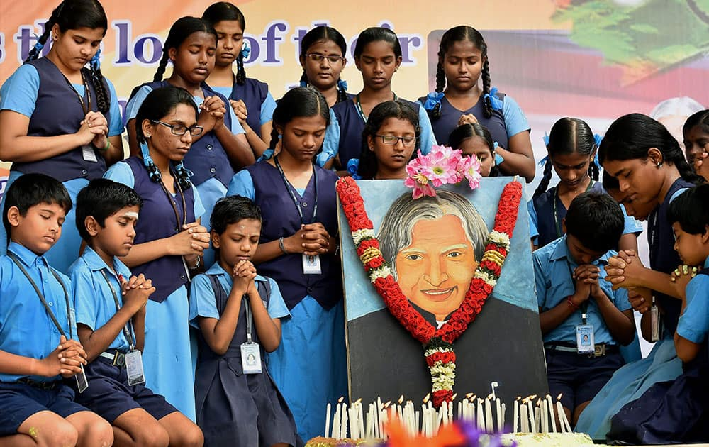 School children pay tribute to former President APJ Abdul Kalam at their school campus in Chennai.