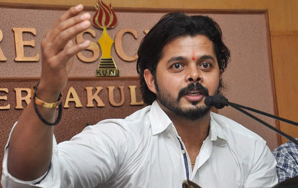 Cricketer S Sreesanth interacts with media at the Ernakulam Press Club in Kochi.