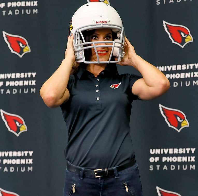 Arizona Cardinals training camp football coach Dr. Jen Welter poses for photographers after being introduced, at the teams' training facility in Tempe, Ariz.
