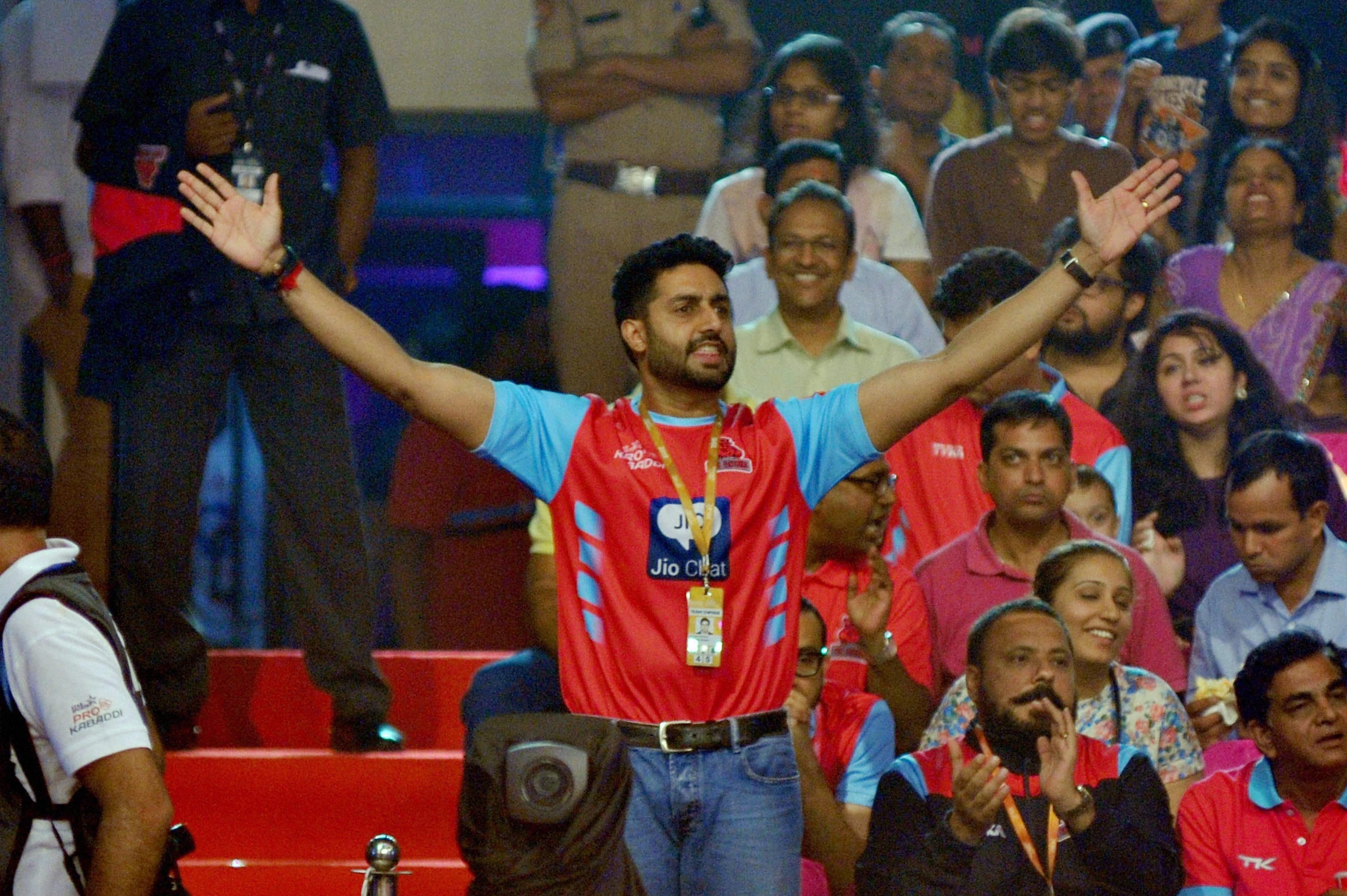 Bollywood actor Abhishek Bachchan cheers during Pro Kabaddi match between Jaipur Pink Panthers and Bengaluru Bulls at Sawai Mansingh Indoor Stadium in Jaipur.