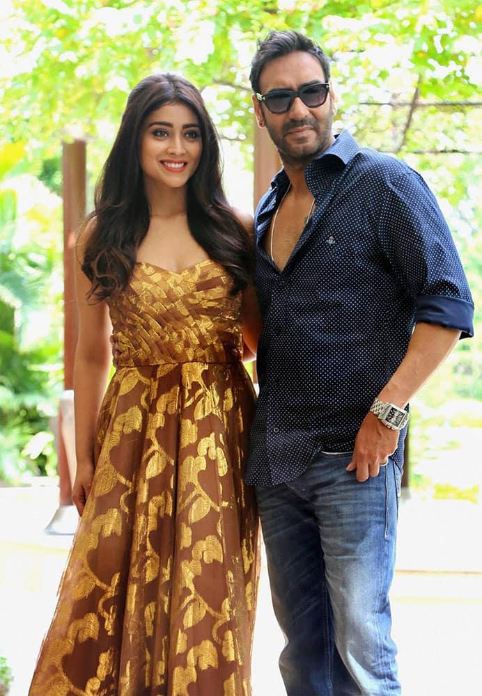 Actors Ajay Devgan and Shriya Saran during a promotional photo shoot for their film Drishyam, in New Delhi.