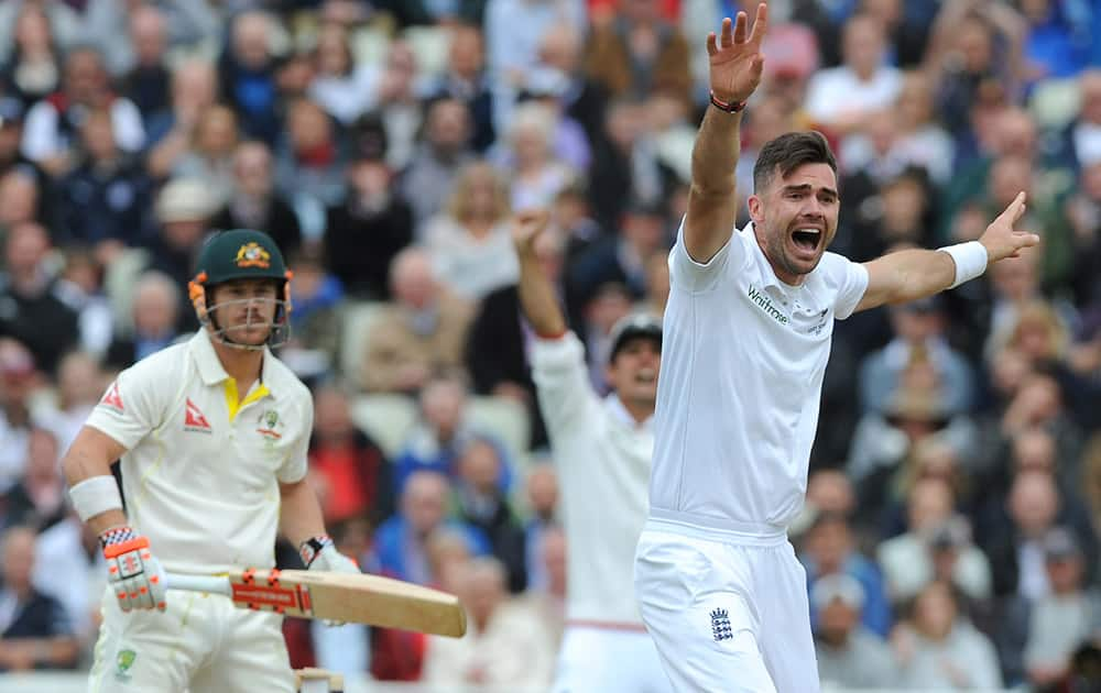 England's James Anderson celebrates after trapping Australia's David Warner, LBW for 2 runs during day one of the third Ashes Test cricket match, at Edgbaston, Birmingham, England.
