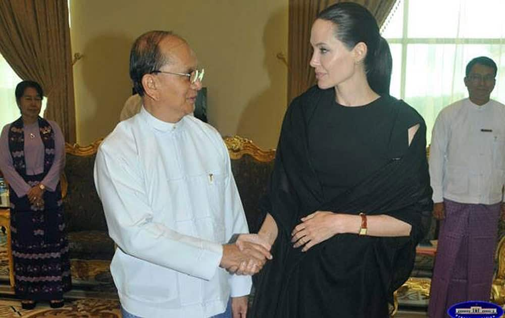 In this image released by the Myanmar President Office, Angelina Jolie Pitt shakes hands with President Thein Sein during their meeting at the presidential palace in Naypyitaw, Myanmar.