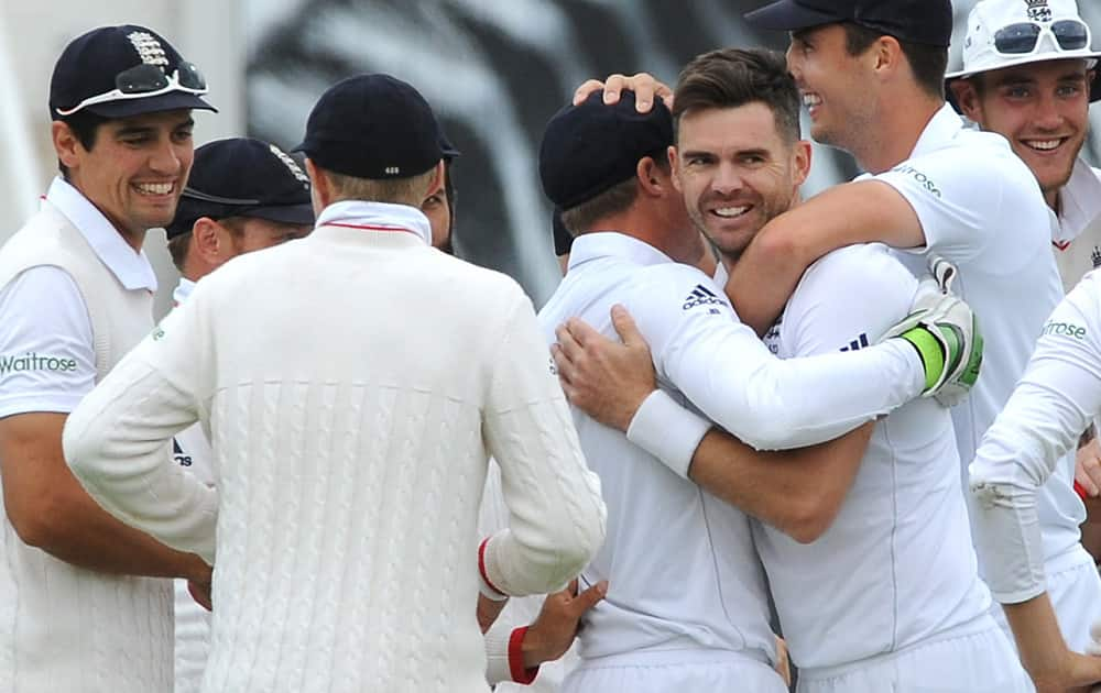 England's James Anderson celebrates with team mates after bowling Australia's Mitchell Marsh caught England's Jos Buttler for a duck during day one of the third Ashes Test cricket match, at Edgbaston, Birmingham, England.