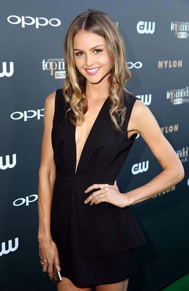 Australian actress Isabelle Cornish poses on the 'green' carpet at the America's Next Top Model Cycle 22 premiere party in Los Angeles.