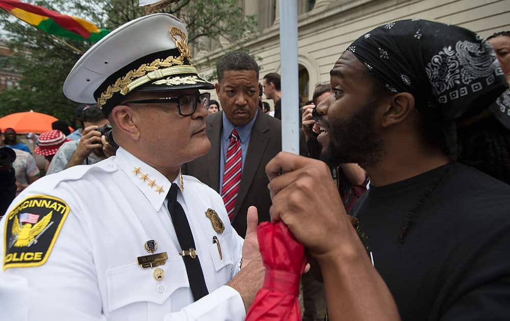 Cincinnati Police Chief Jeffrey Blackwell, left, speaks with a protestor during a demonstration outside the Hamilton County Courthouse after murder and manslaughter charges against University of Cincinnati police officer Ray Tensing were announced for the traffic stop shooting death of motorist Samuel DuBose in Cincinnati.