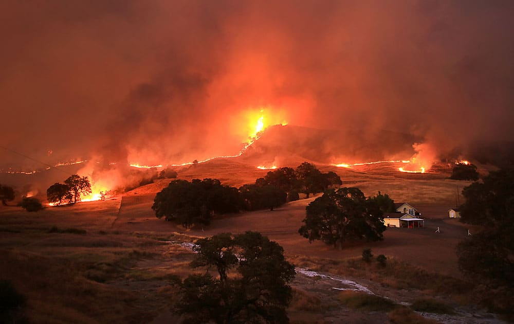Flames consume the landscape at the Rocky Fire, near Lower Lake, Calif.