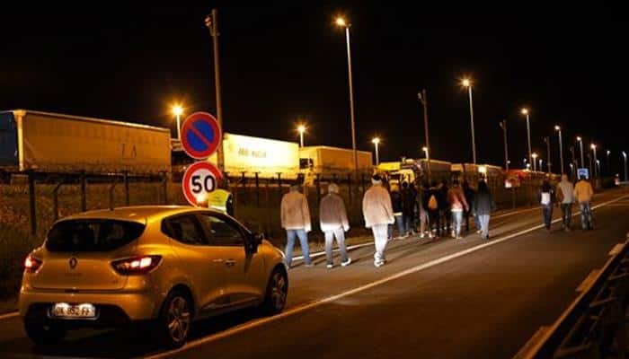 Migrants throng near Channel Tunnel for third night in a row