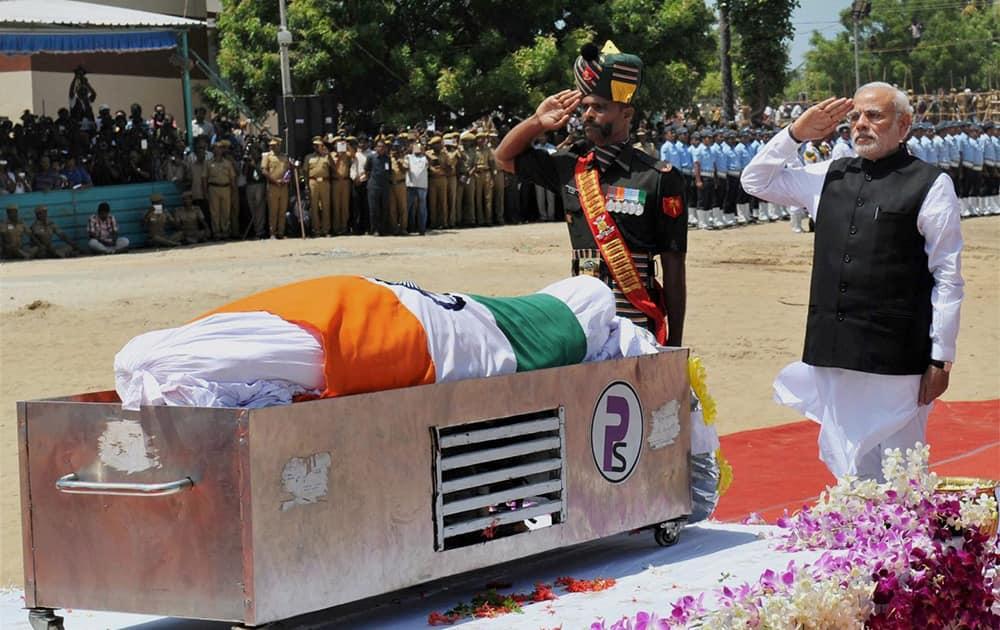 Prime Minister Narendra Modi pays homage to former President APJ Abdul Kalam at his burial site in Rameswaram.