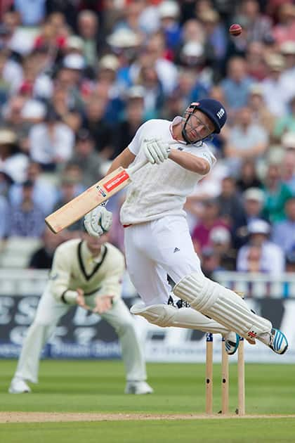 England's Jonny Bairstow reels away from as bouncer as he looses his wicket for 5 caught by Peter Nevill off the bowling of Australia's Mitchell Johnson on the second day of the third Test match of the five match series between England and Australia at Edgbaston cricket ground in Birmingham, England.
