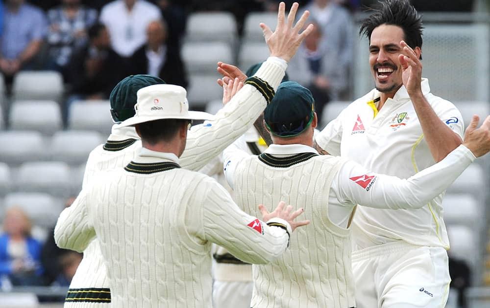Australia's Mitchell Johnson celebrates England's Ben Stokes wicket during day two of the third Ashes Test cricket match, at Edgbaston, Birmingham, England.