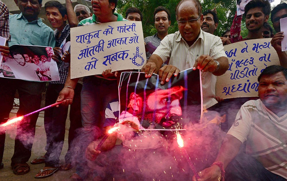 People celebrate the hanging of 1993 Bombay blast accused Yakub Memon with fire crackers in Ahmedabad.
