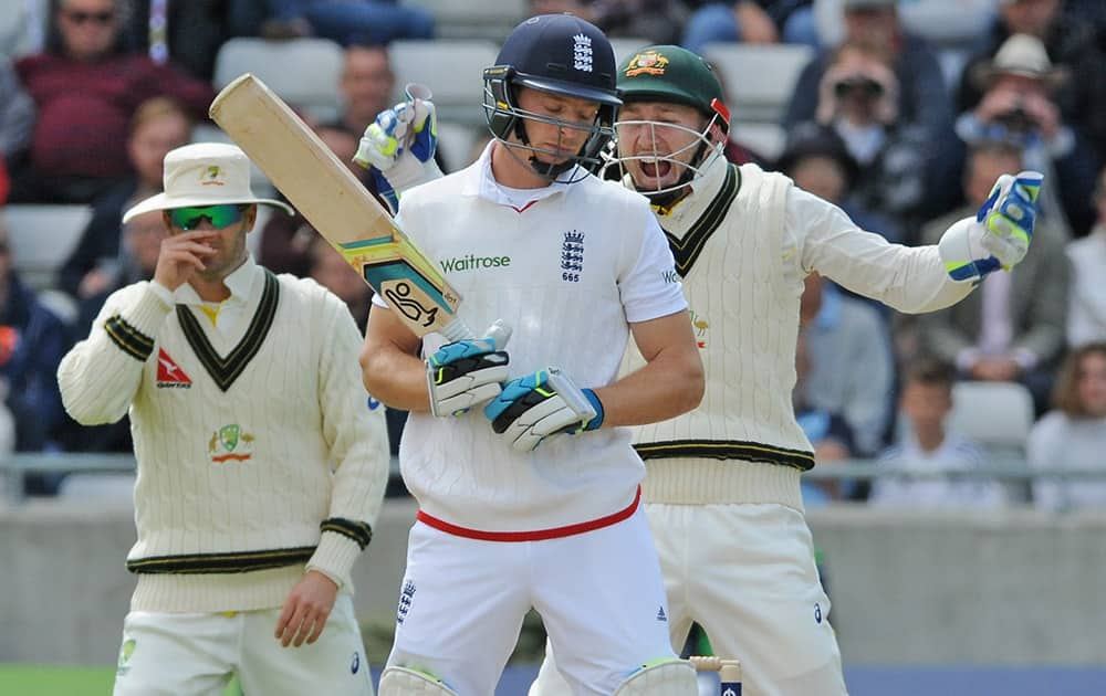 Australia's Peter Nevill celebrates after England's Jos Buttler is trapped LBW by Australia's Nathan Lyon for 9 runs during day two of the third Ashes Test cricket match, at Edgbaston, Birmingham, England.