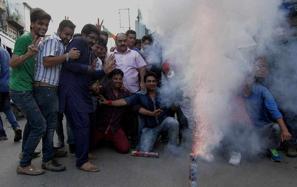BJP workers burst crackers as they celebrate the announcement of AIIMS for Jammu by Union Health Minister JP Nadda, in Jammu.