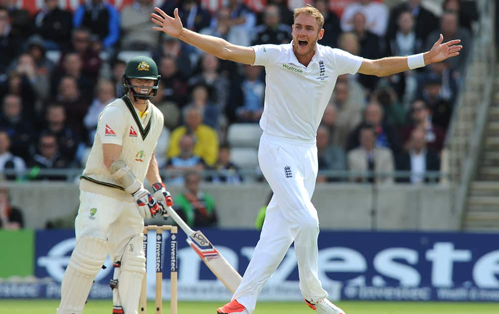 England's Stuart Broad, right, celebrates after trapping Australia's Chris Rogers, left, LBW for 6 runs during day two of the third Ashes Test cricket match, at Edgbaston, Birmingham, England.