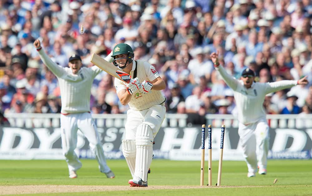 Australia's Mitchell Marsh is bowled for six by England's Steven Finn on the second day of the third Test match of the five match series between England and Australia at Edgbaston cricket ground in Birmingham, England.