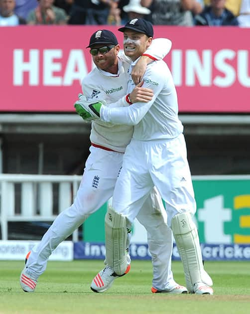 England's Ian Bell celebrates with England's Jos Buttler after Australia's Peter Nevill is bowled by England's Steven Finn caught Jos Buttler for 59 runs during day three of the third Ashes Test cricket match, at Edgbaston, Birmingham, England.