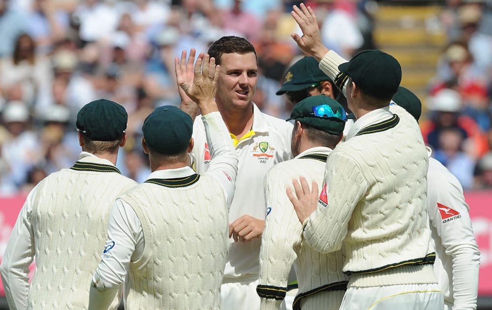 Australia's Josh Hazlewood is congratulated by teammates after trapping England's Adam Lyth LBW during day three of the third Ashes Test cricket match, at Edgbaston, Birmingham, England.
