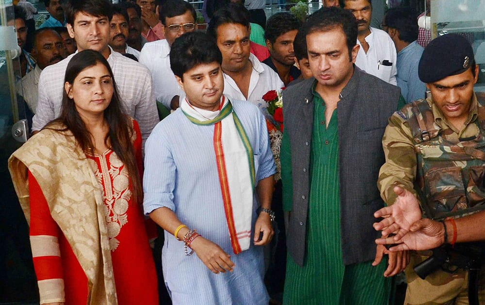Congress leader and MP Jyotiraditya Scindia being welcomed by party workers on his arrival at Raja Bhoj airport in Bhopal.