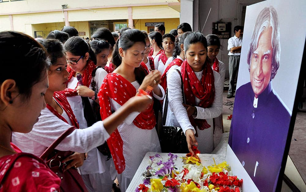 Students paying floral tribute on the portrait of former president APJ Abdul Kalam on the first day of college session at Handique Girls College in Guwahati.