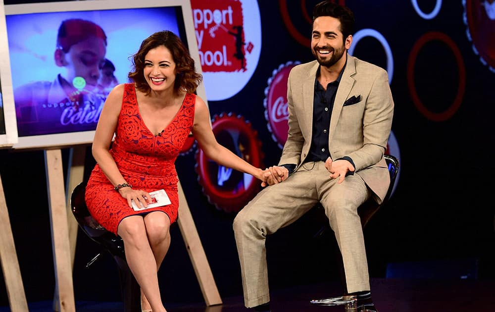 Bollywood actors Ayushmaan Khurana and Dia Mirza share a moment during the celebration of success of Support My School campaign in Bengaluru.