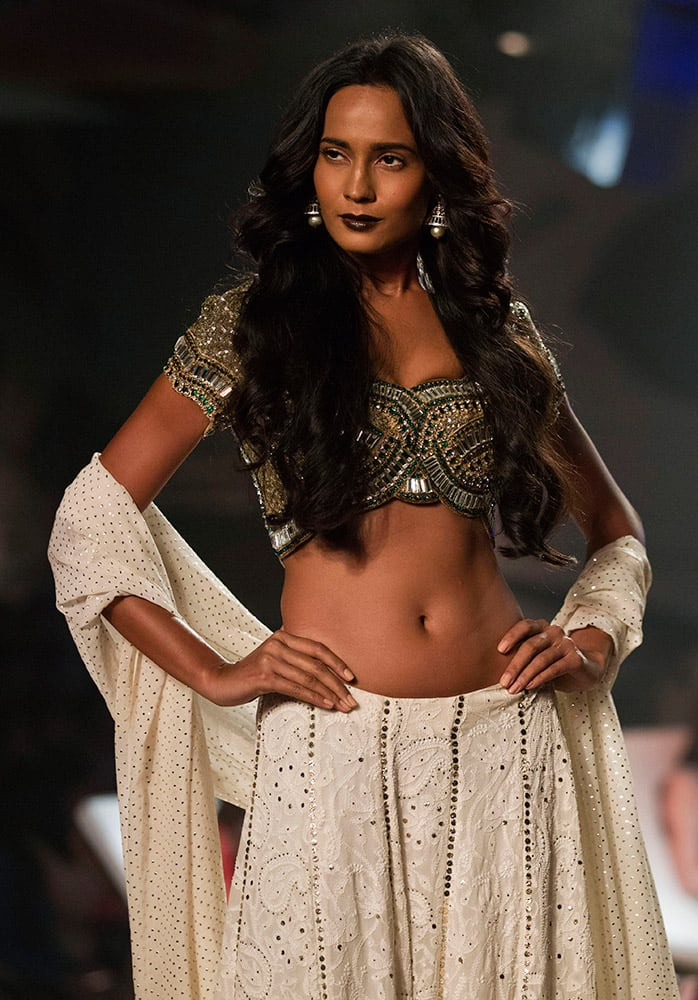 A models displays a creation by designer Monisha Jaising at the Amazon India Couture Week 2015 in New Delhi.