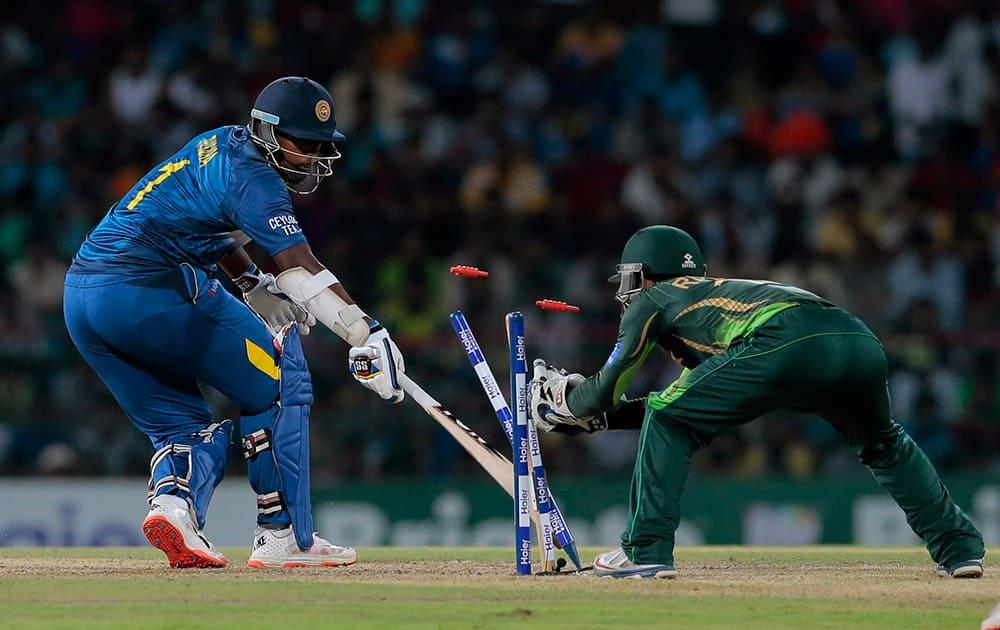 Pakistan's wicketkeeper Rizwan Ali successfully dislodge the bails to dismiss Sri Lanka's Thisara Perera during the second Twenty20 cricket match between them in Colombo, Sri Lanka.