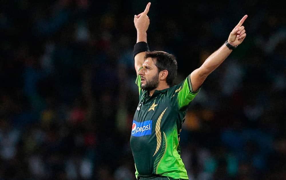 Pakistans Shahid Afridi celebrates the dismissal of Sri Lankas Dhananjaya de Silva during the second Twenty20 cricket match between them.