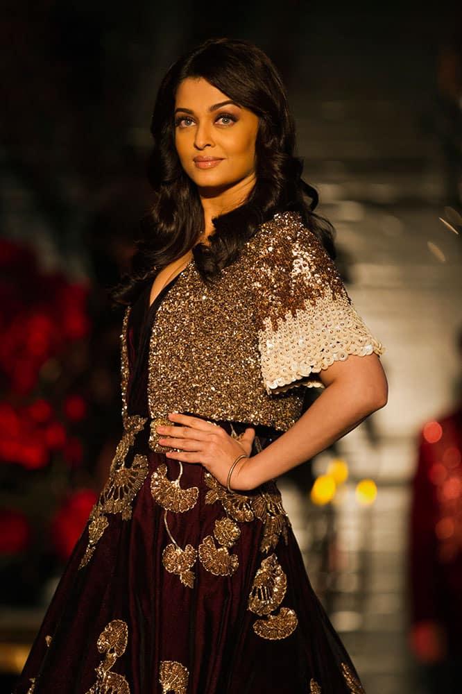 Bollywood actor Aishwarya Rai Bachchan displays a creation by Indian designer Manish Malhotra at the Amazon India Couture Week 2015 in New Delhi.