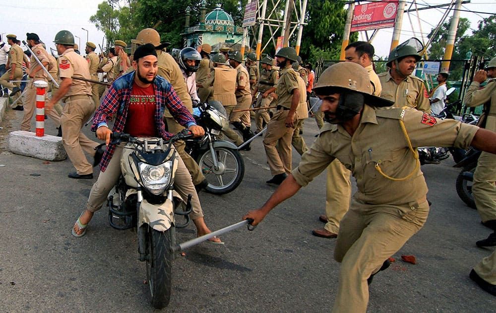 Police Trying to chasing stone pelters during Massive Protest under the Banner of AIIMS Coordination Committee 4th Day Jammu Bandh.