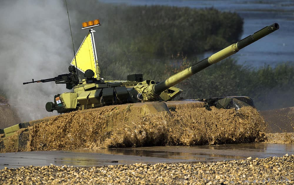 An Indian tank emerges from the water during competition in Alabino, outside Moscow, Russia.