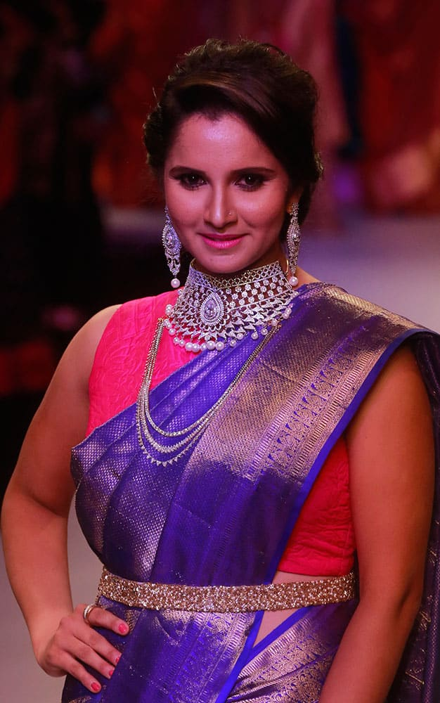 Indian Tennis player Sania Mirza displays the creations of Moni Agarwal during a fashion show at the India International Jewelry Week in Mumbai.