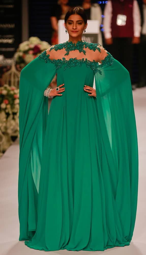 Sonam Kapoor greets as she walks the ramp during a fashion show at the India International Jewellery Week in Mumbai.