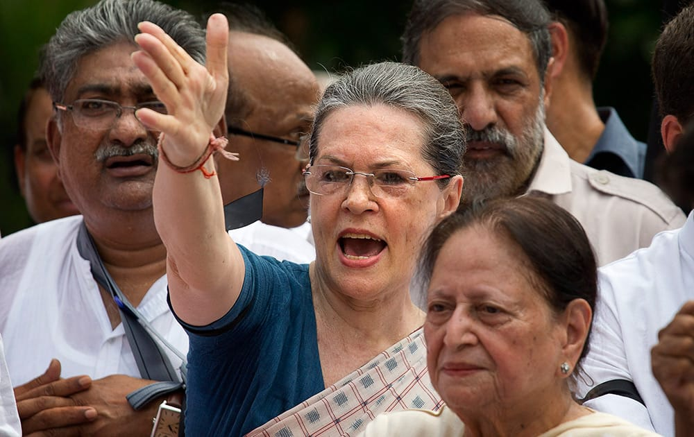 Sonia Gandhi and other Congress party lawmakers shout slogans against the government during a protest in the parliament premises, in New Delhi.