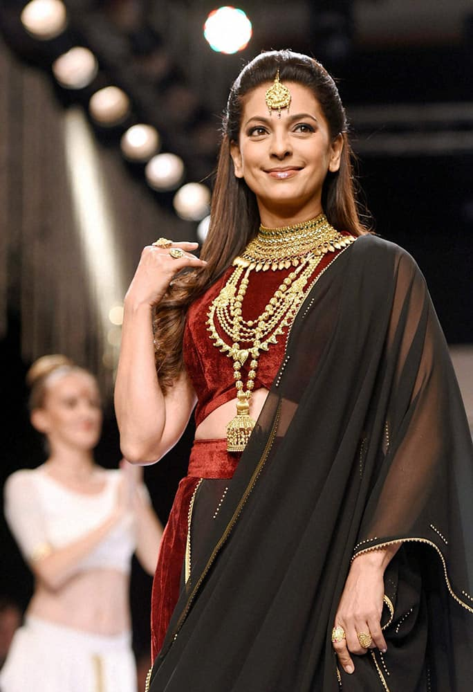 Juhi Chawla walks the ramp at India International Jewellery Week in Mumbai.