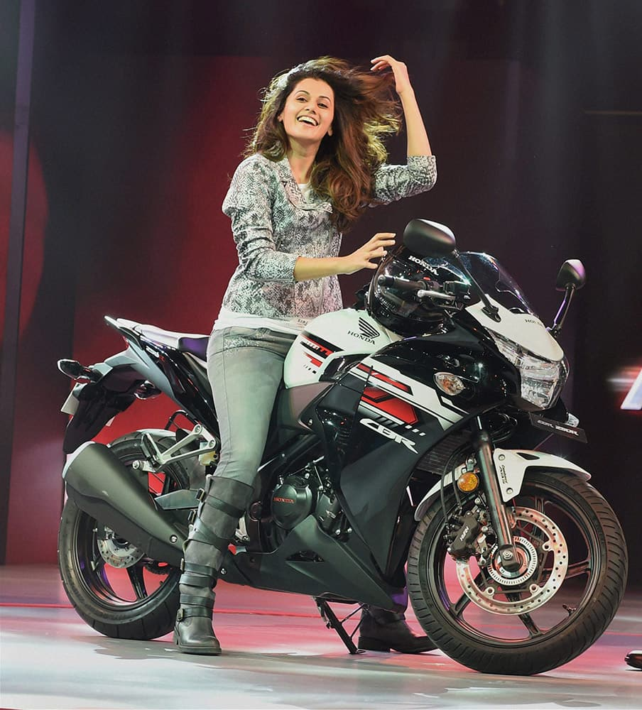 Honda Brand Ambassador Tapsee Pannu riding a Honda CBR bike during its launch in New Delhi.