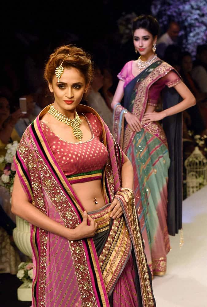 Model walk the ramp during a fashion show at India International Jewellery Week in Mumbai.
