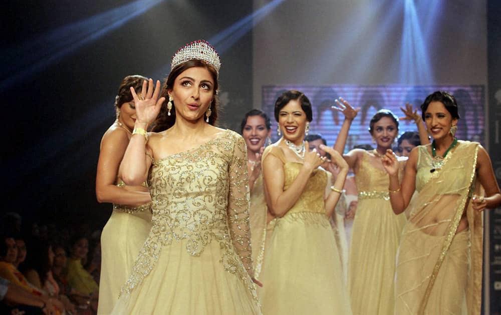 Actress Soha Ali Khan walks the ramp with models at India International Jewellery Week in Mumbai.