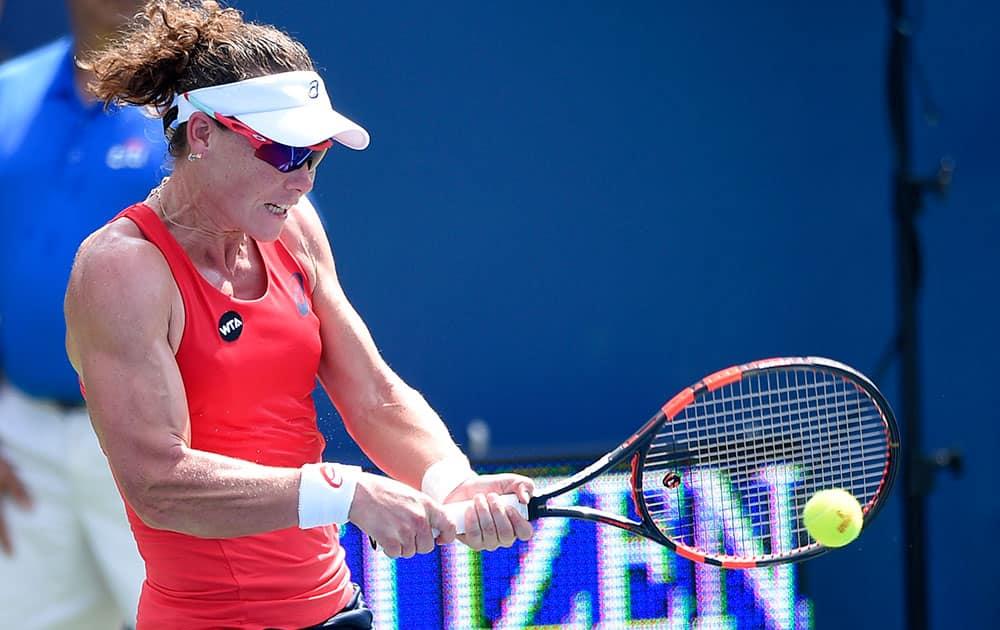 Samantha Stosur, of Australia, returns the ball against Kristina Mladenovic, of France, at the Citi Open tennis tournament in Washington.