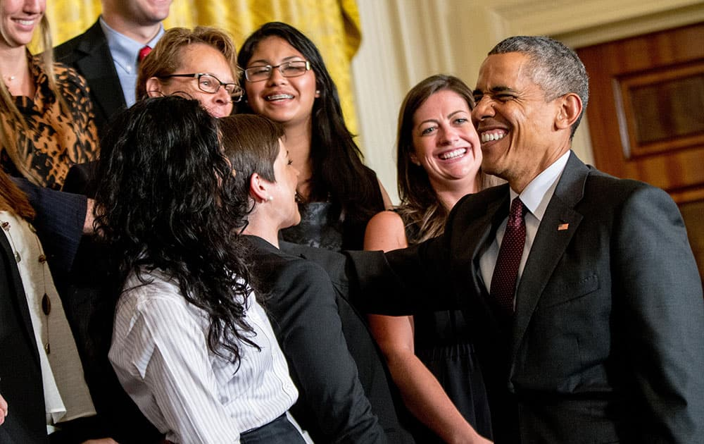 President Barack Obama reacts as the audience sings him