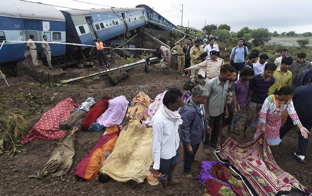 People try to identify relatives near the wreckage of Kamayani Express and Janata Express trains which derailed within minutes of each other while crossing a small bridge at Harda in Madhya Pradesh.