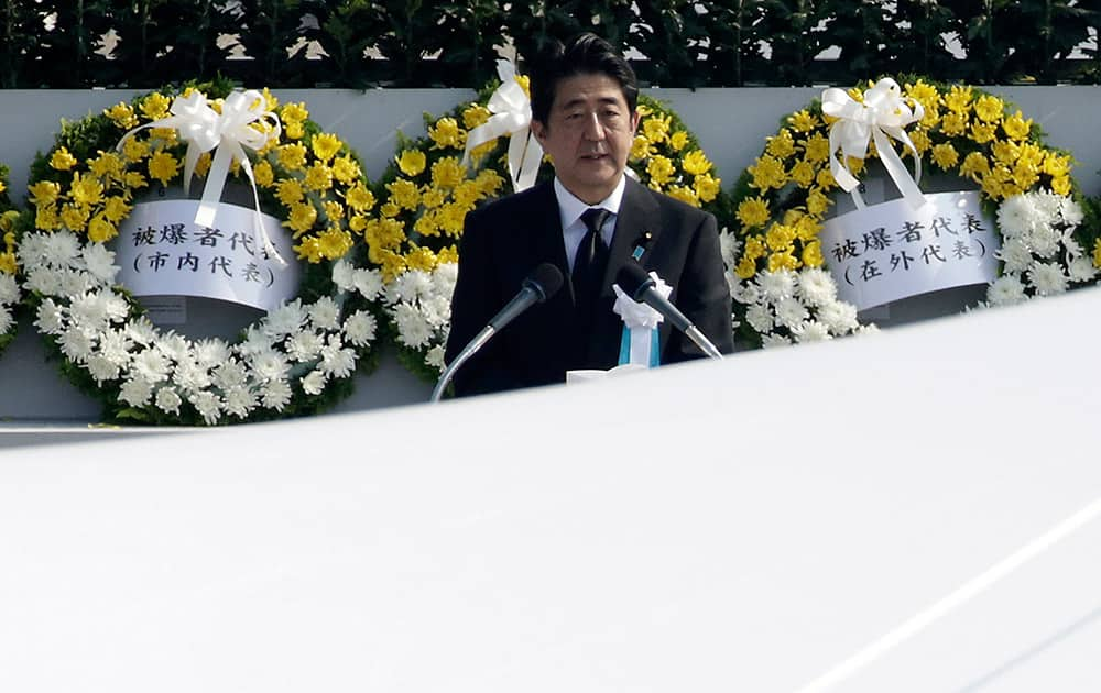 Japanese Prime Minister Shinzo Abe delivers a speech during the ceremony to mark the 70th anniversary of the bombing at the Hiroshima Peace Memorial Park in Hiroshima, western Japan.