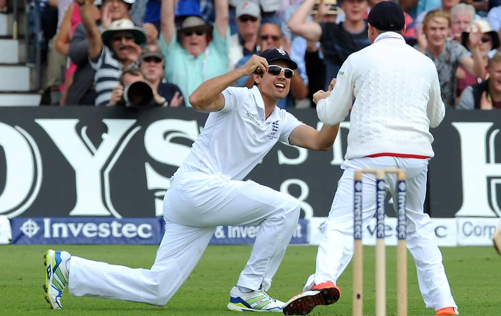 England's Alastair Cook, left, celebrates after catching Australia's Chris Rogers bowled Stuart Broad for a duck during day one of the fourth Ashes Test cricket match, at Trent Bridge, Nottingham, England.