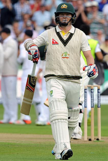 Australia's Chris Rogers walks back to the pavilion after being bowled by Stuart Broad caught England's Alastair Cook for a duck during day one of the fourth Ashes Test cricket match, at Trent Bridge, Nottingham, England.