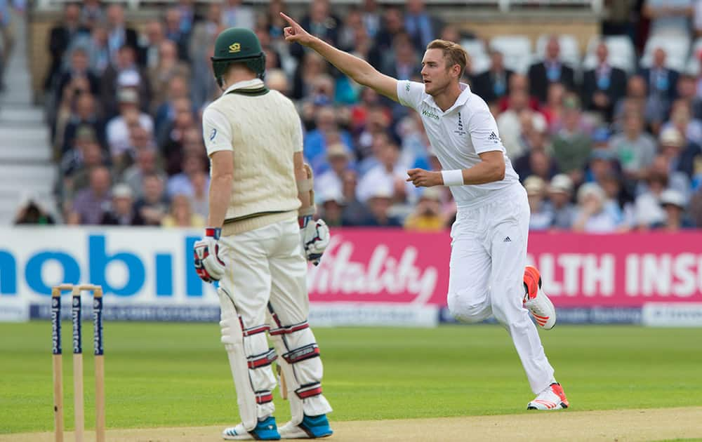 England's Stuart Broad celebrates his 300th test wicket, that of Australia's Chris Rogers, left, caught by Alastair Cook for 0, on the first day of the fourth Ashes test cricket match between England and Australia at Trent Bridge cricket ground in Nottingham.