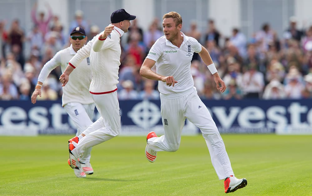 England's Stuart Broad, right, celebrates taking the wicket of Australia's Steve Smith caught by Joe Root for 0 on the first day of the fourth Ashes test cricket match between England and Australia at Trent Bridge cricket ground in Nottingham.