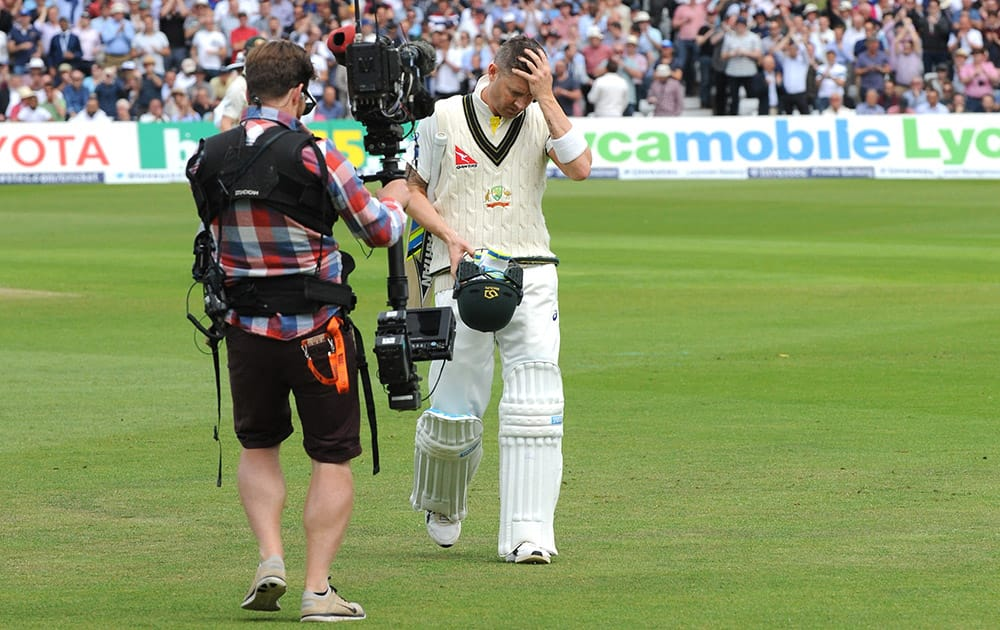 Australia's Michael Clarke returns to the pavilion after being bowled by England's Stuart Broad caught Alastair Cook for 10 runs during day one of the fourth Ashes Test cricket match, at Trent Bridge, Nottingham, England.
