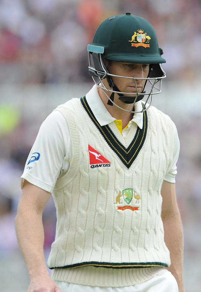 Australia's Adam Voges returns to the pavilion after being bowled by England's Stuart Broad caught England's Ben Stokes for 1 run during day one of the fourth Ashes Test cricket match, at Trent Bridge, Nottingham, England.