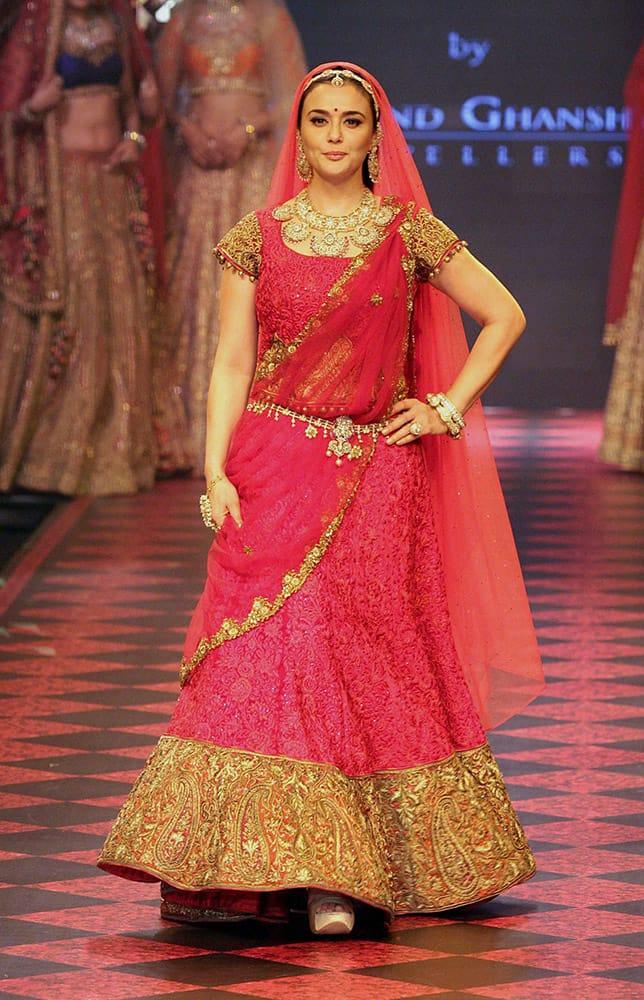 Bollywood actress Preity Zinta walks the ramp during India International Jewellery Week 2015, in Mumbai.