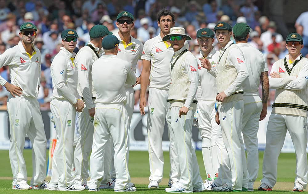 Australia team look at a replay on a TV screen after Australia's Mitchell Starc bowled England's Adam Lyth caught Peter Nevill for 14 runs during day one of the fourth Ashes Test cricket match, at Trent Bridge, Nottingham, England.